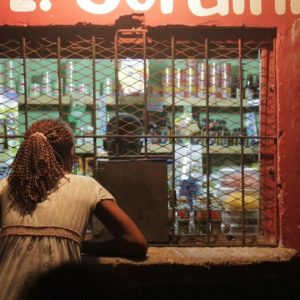 At night, standing outside of a vendor's window.