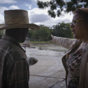 Gladys Felix-Pimentel with a Haitian male at Massacre River.