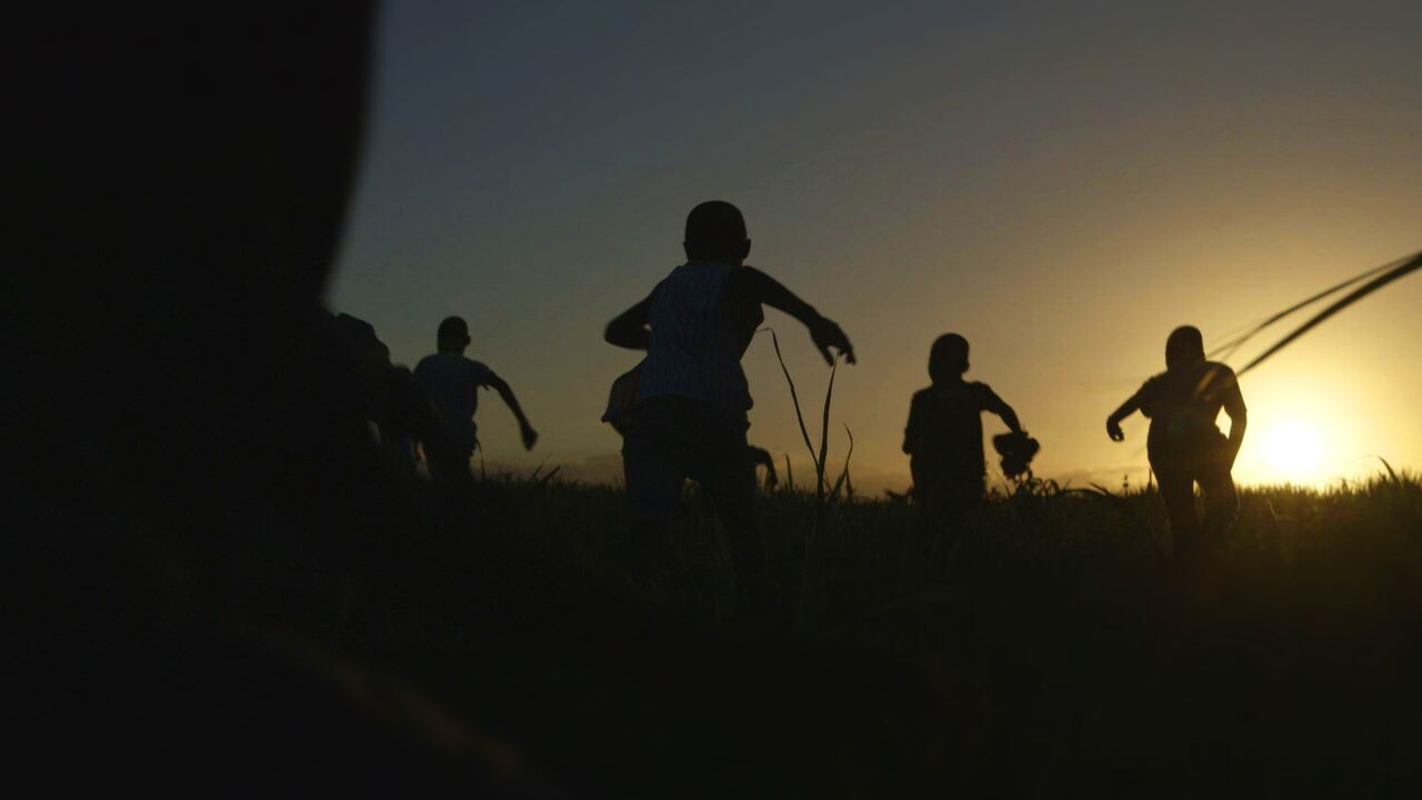 Children running in the sunset.